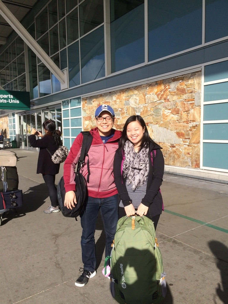 Us at YVR, facing the sun. Which is why my eyes are closed