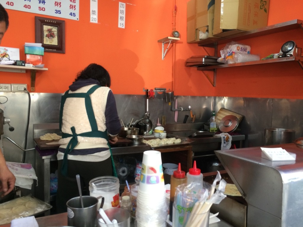 Lady making our green onion pancake