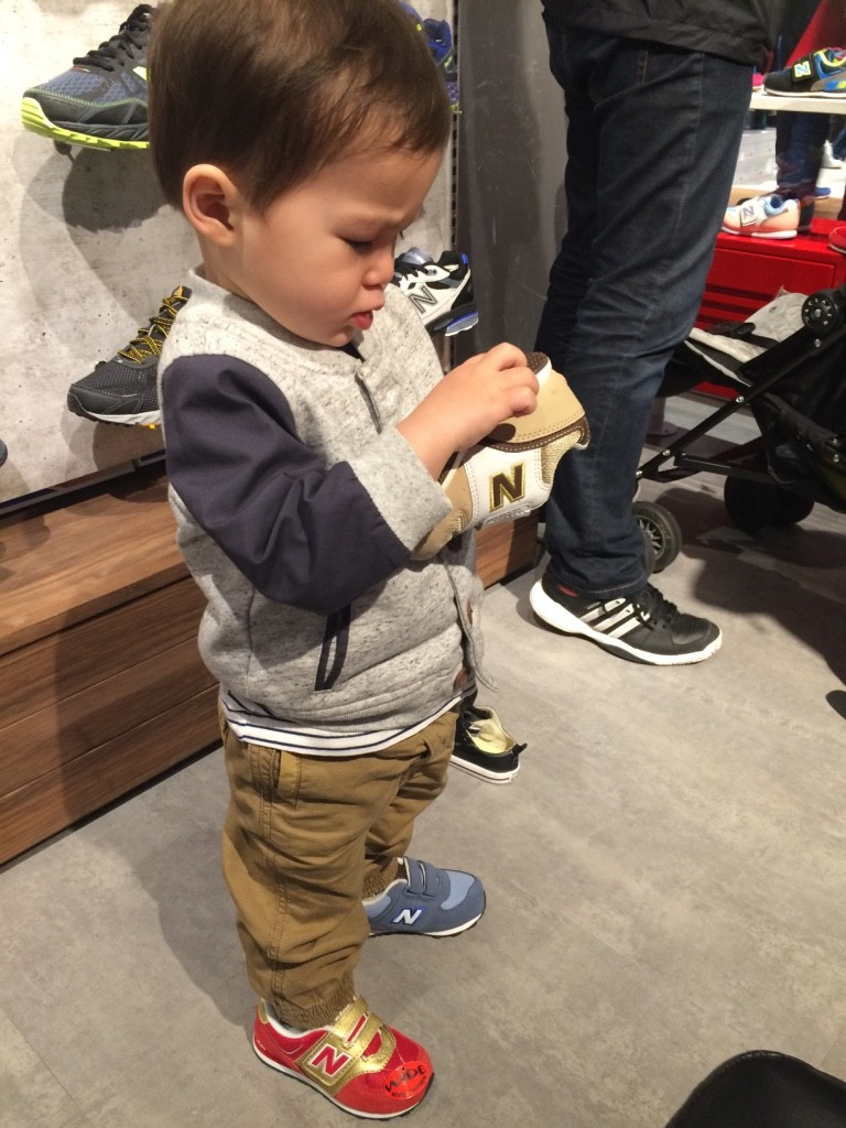 Nate trying on some shoes at New Balance