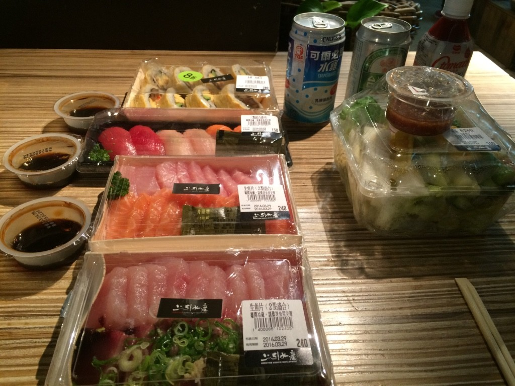 This is what we ended up getting for the three of us, we could've done without one of the trays. We were stuffed. Sashimi trays were 240 NT = $9.70 CAD, 6 pieces of nigiri 150 NT = $6 CAD, Egg wrapped dynamite/futomaki-ish roll for 225 NT = $9 CAD, salad was $4.45 CAD