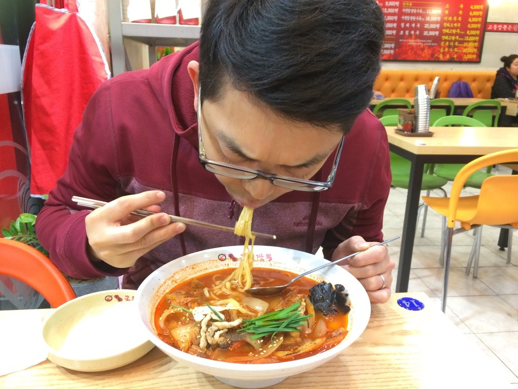 Tim eating his spicy noodles - it was spicy but very tasty (5000 KRW = $5.65 CAD)