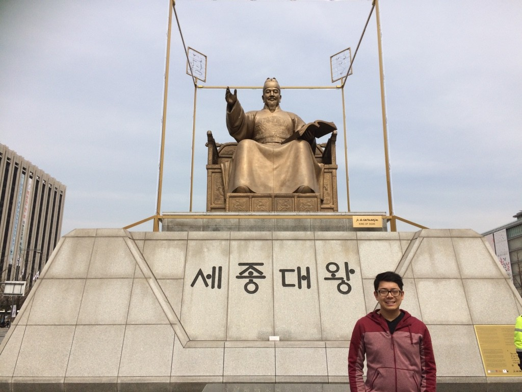 Tim in front of the King Sejong statue. He was the inventor of the Korean alphabet