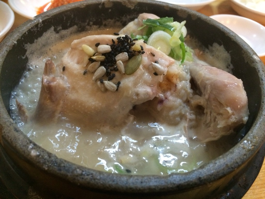 Ginseng chicken soup. It was a whole chicken in a simmering ginseng broth with congee like rice