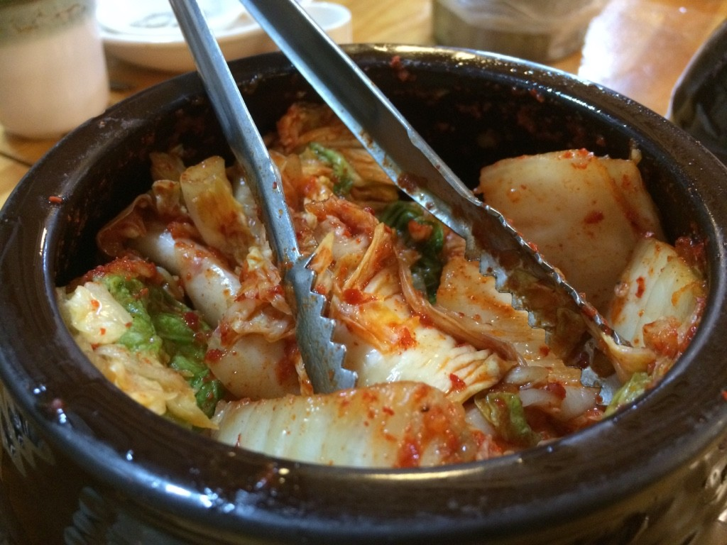 Our first kimchi in Korea. They leave a pot of kimchi and daikon kimchi on the table. You can take as much as you like
