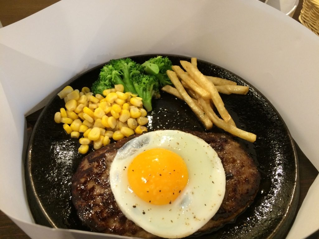 My hamburger steak with an egg. 830 JPY = $9.45 and 100 JPY = $1.13 CAD more for the egg.