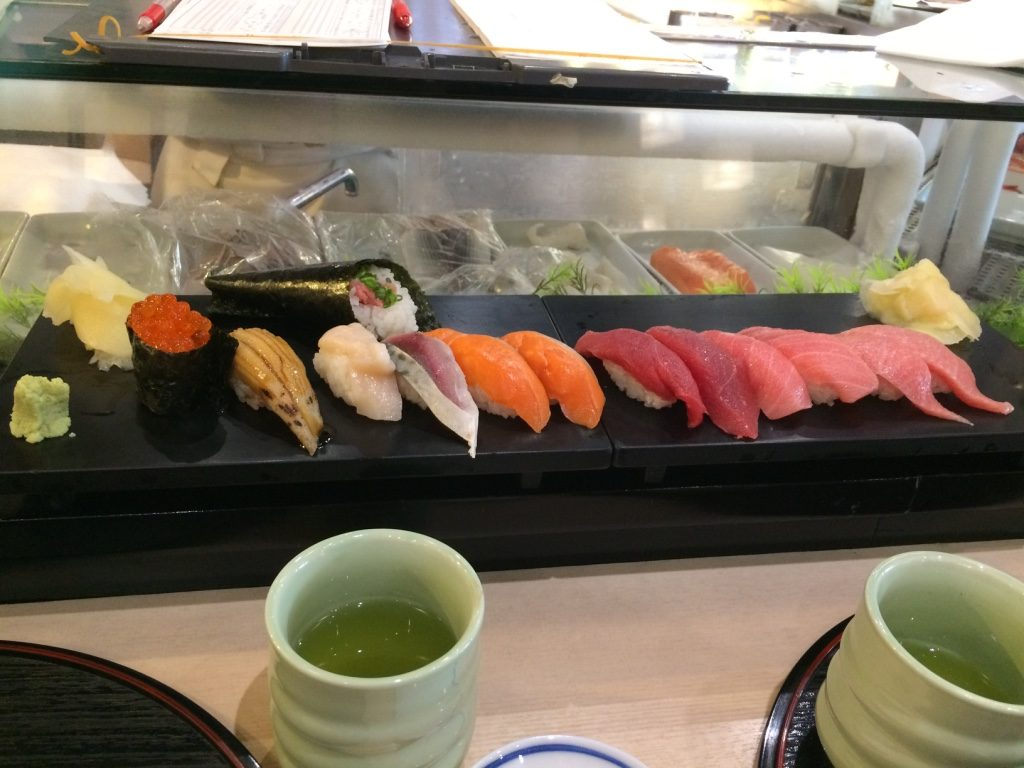 Our sushi: ikura, unagi, scallop, salmon, red tuna, medium fatty tuna and fatty tuna. I ordered a negitoro cone at the top.