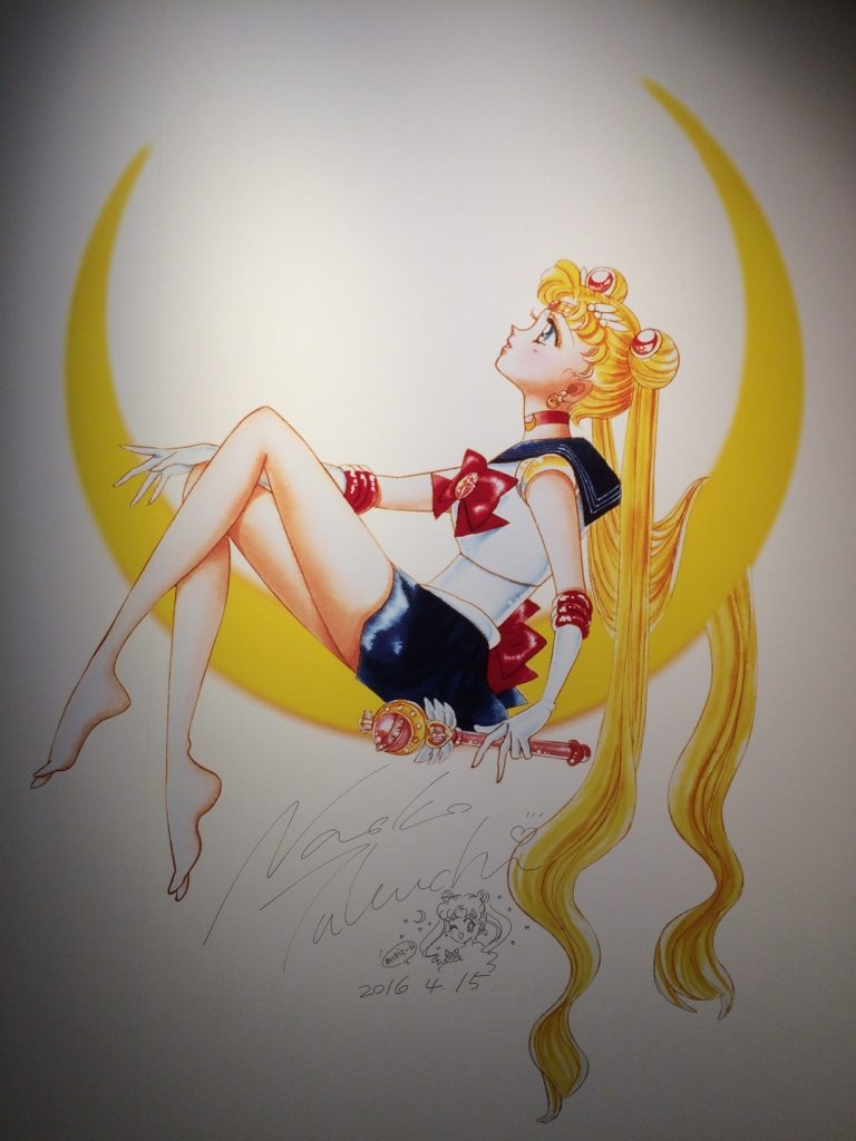 Sailor Moon painting with the author's signage for this exhibit