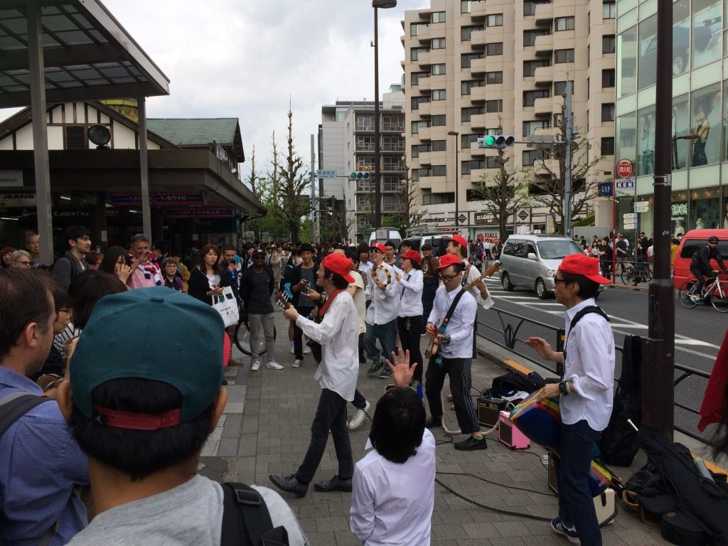 A fun and lively performance by a group of guys outside Harajuku Station