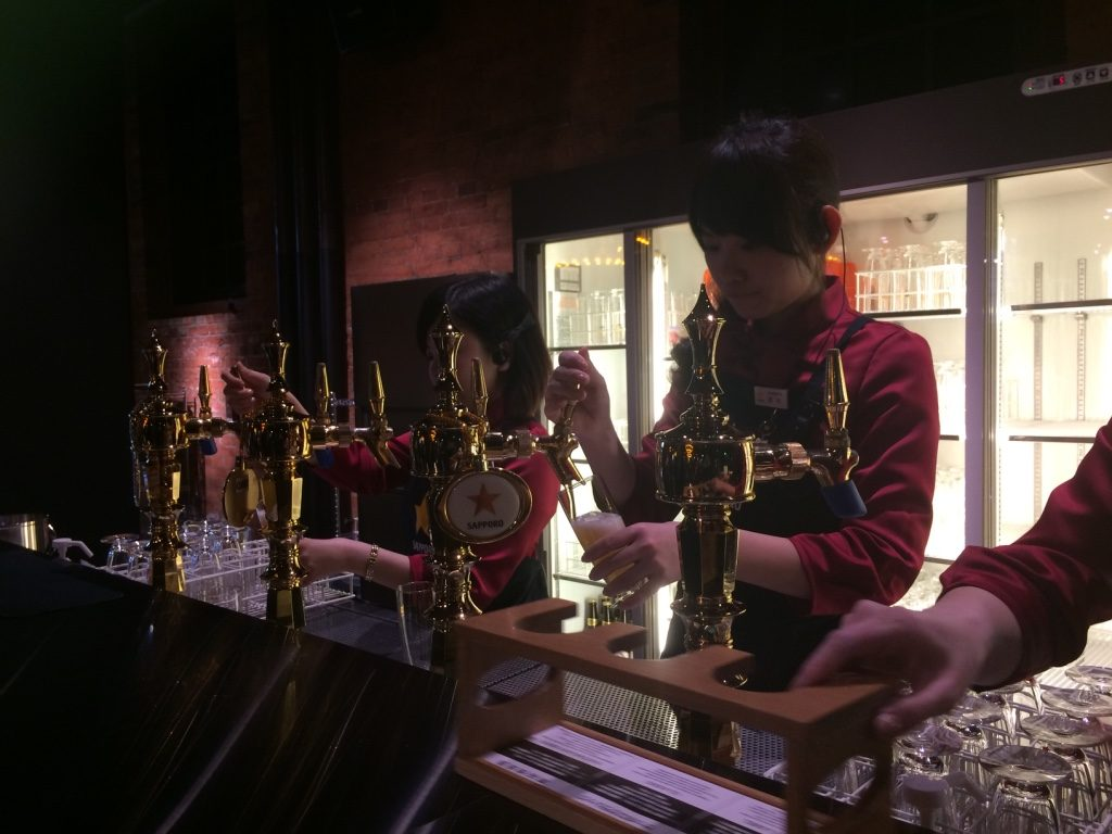 Sapporo girls pouring the beer