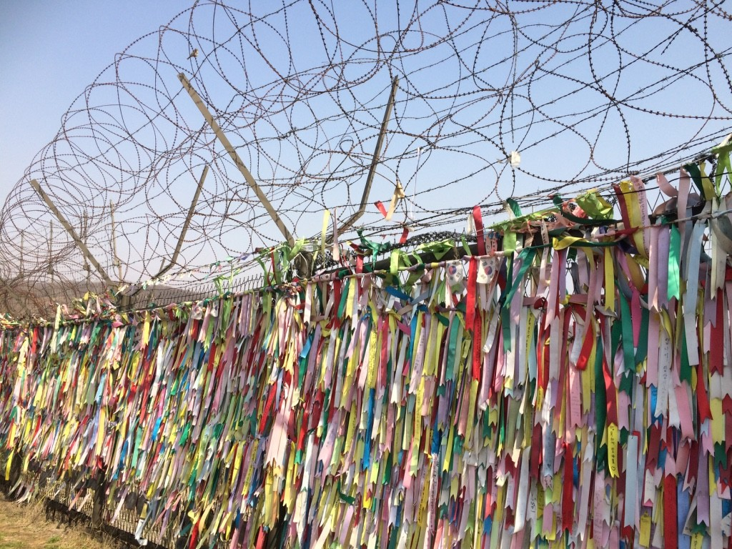 Messages all around the barbed wire