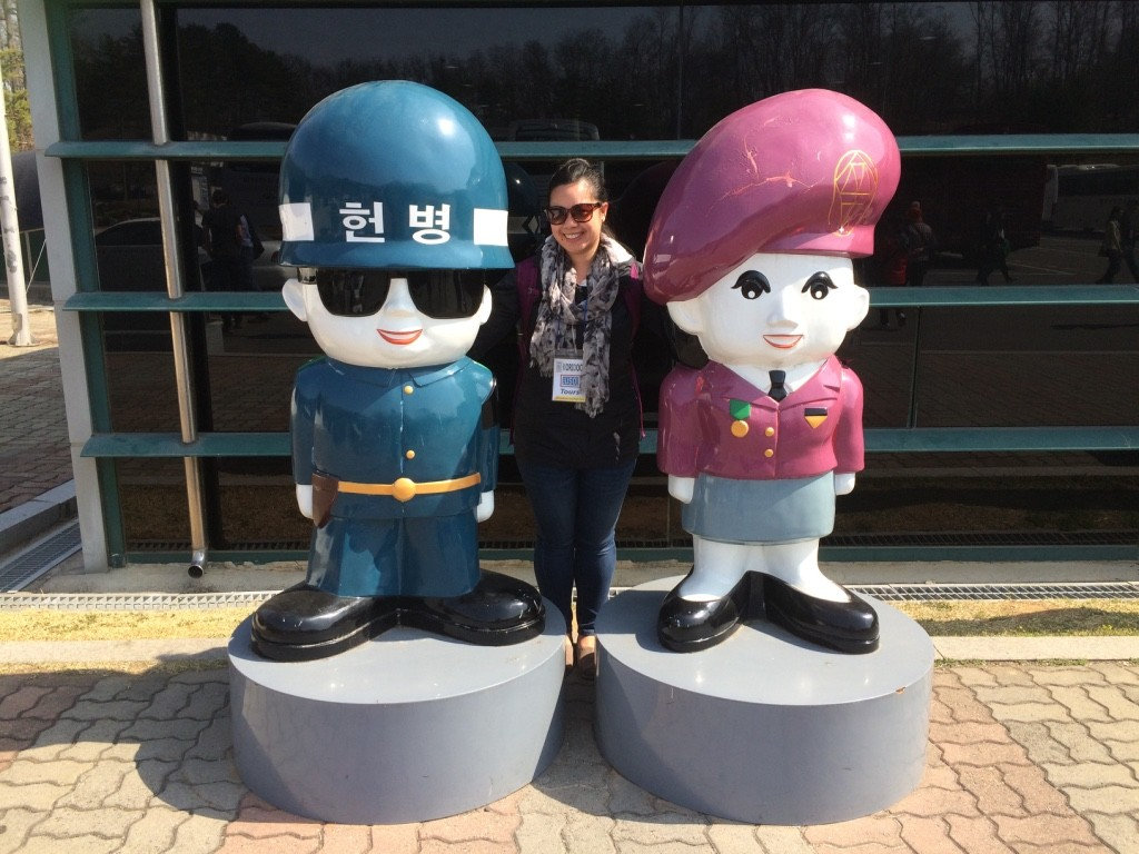 Posing with cartoon Korean military personnel