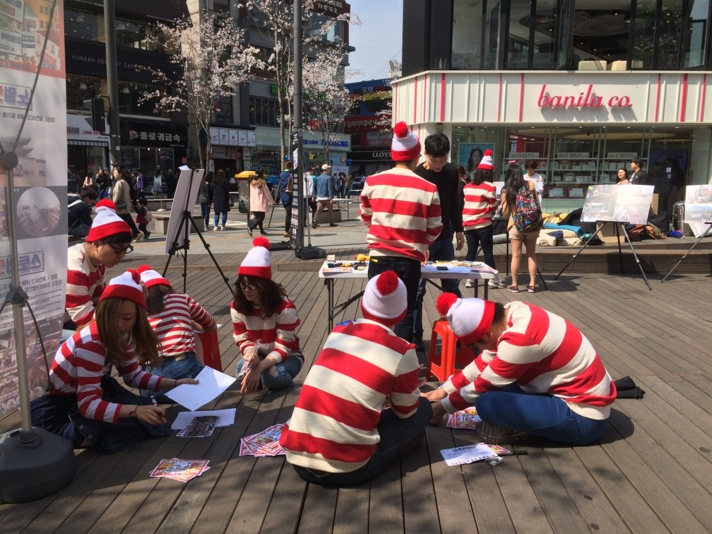 "There was a ""Where's Wally"" exhibit going on in the middle of the sidewalk. In Asia, it's not Waldo, it's Wally!"