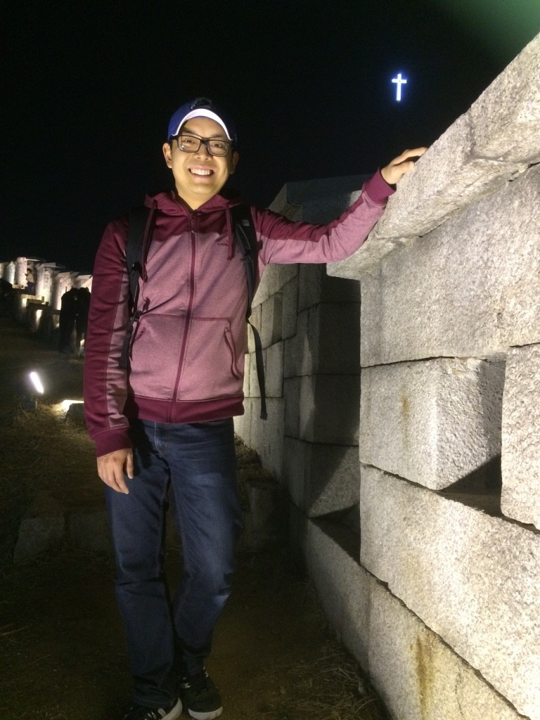 Tim touching the remains of Seoul's city wall