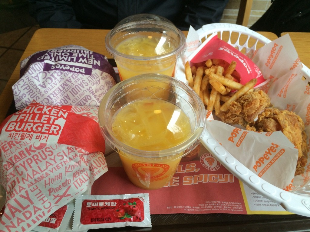 The combo included two chicken sandwiches, two pieces of fried chicken, fries and two drinks. We thought we were trying a Korean orange soda, but it turned out to be orange juice