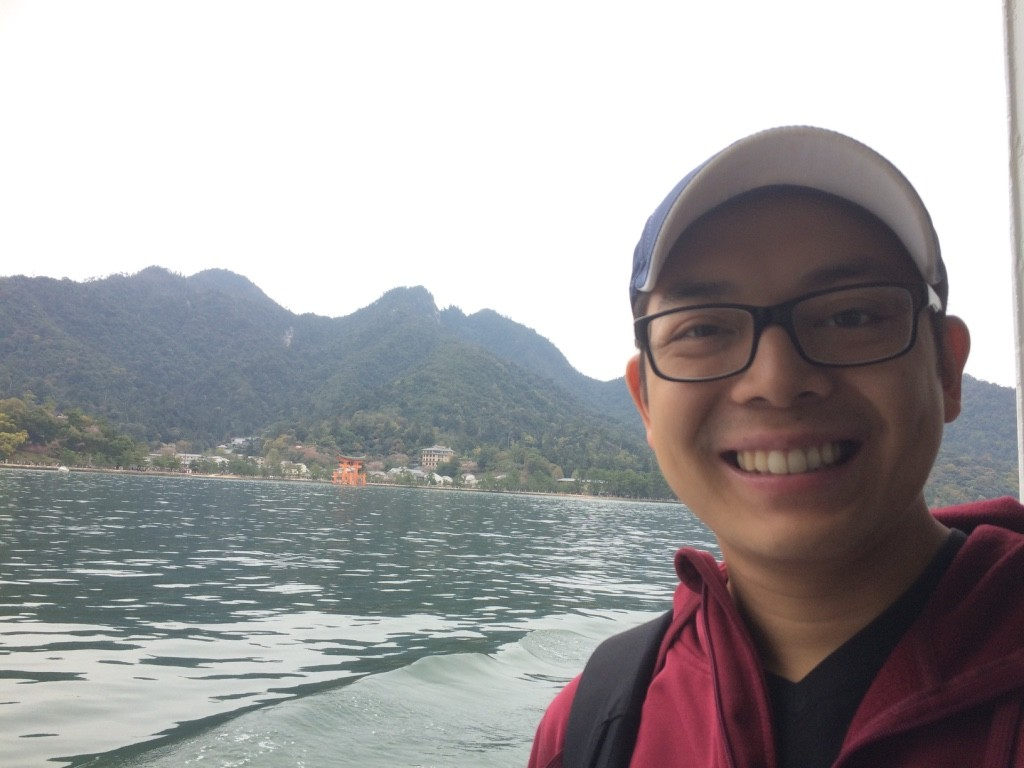 """On the ferry to Itsukushima. You can see the O-torii Gate (""""floating"""" red gate) in the background"""