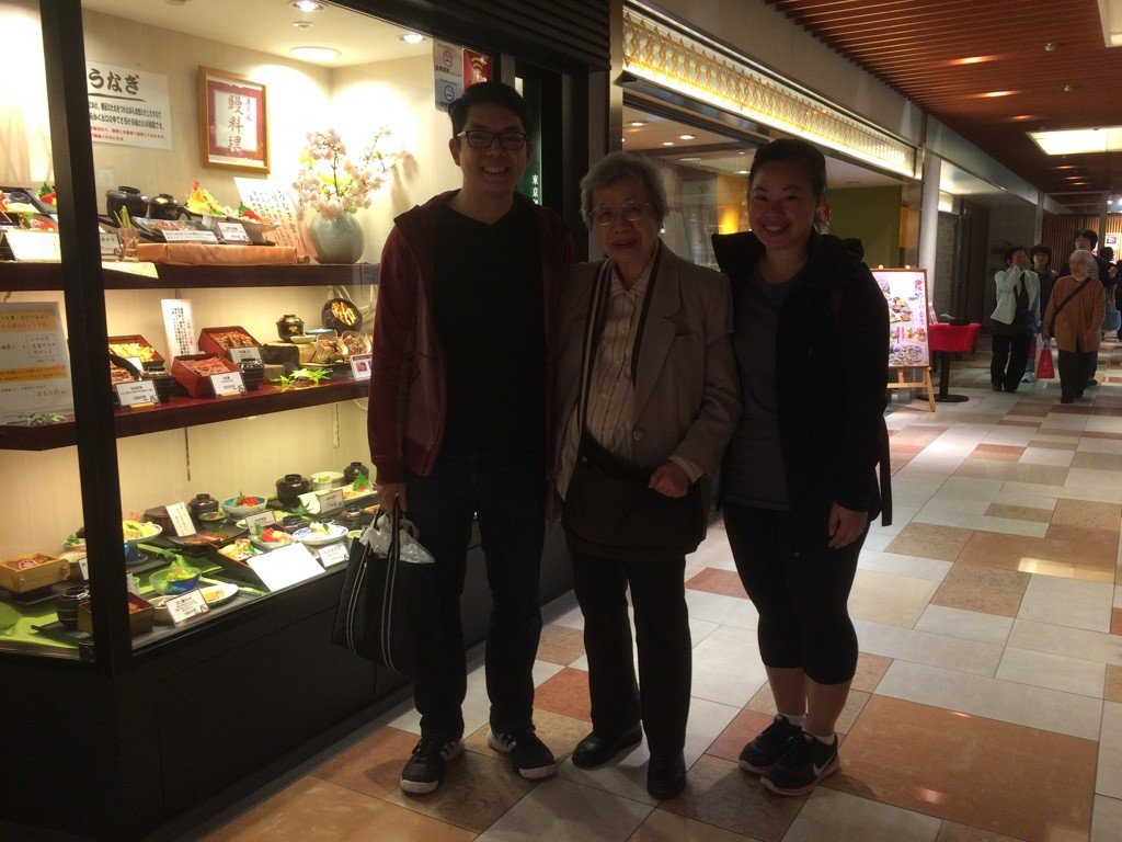 Us with 7-Yi Ma (Great Aunt) outside the restaurant in Osaka