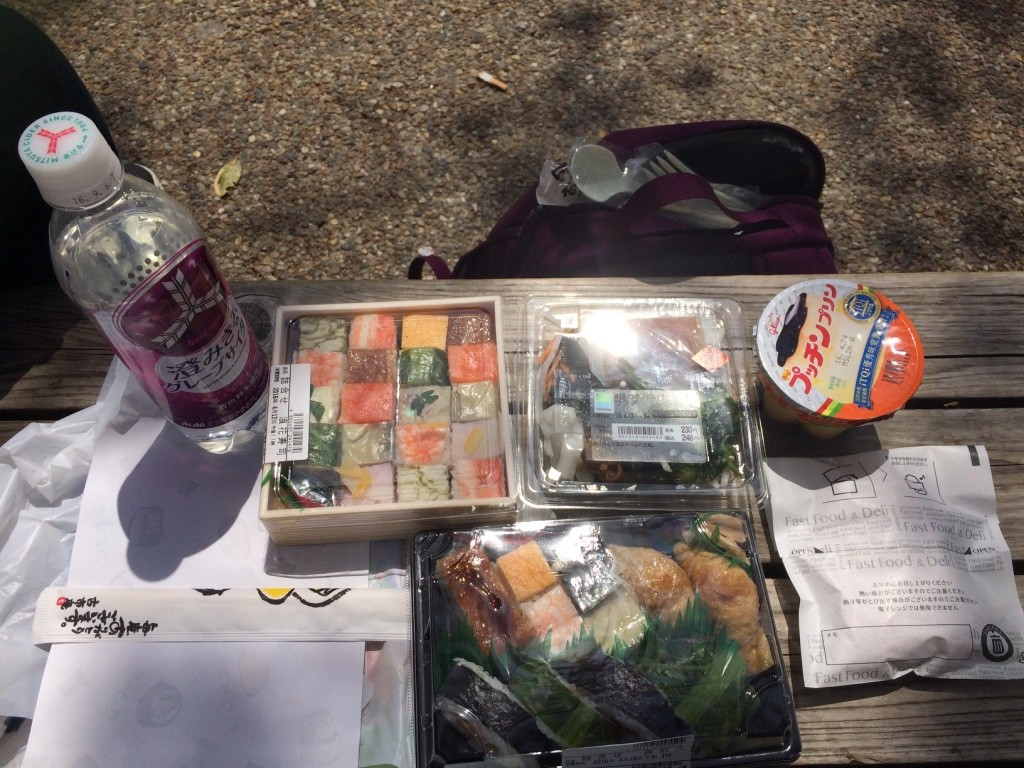 Carbonated grape drink from Family Mart, Tim's battera bento, Family Mart daikon, seaweed and okra salad, Glico pudding, my sushi combo and the Family Mart chicken