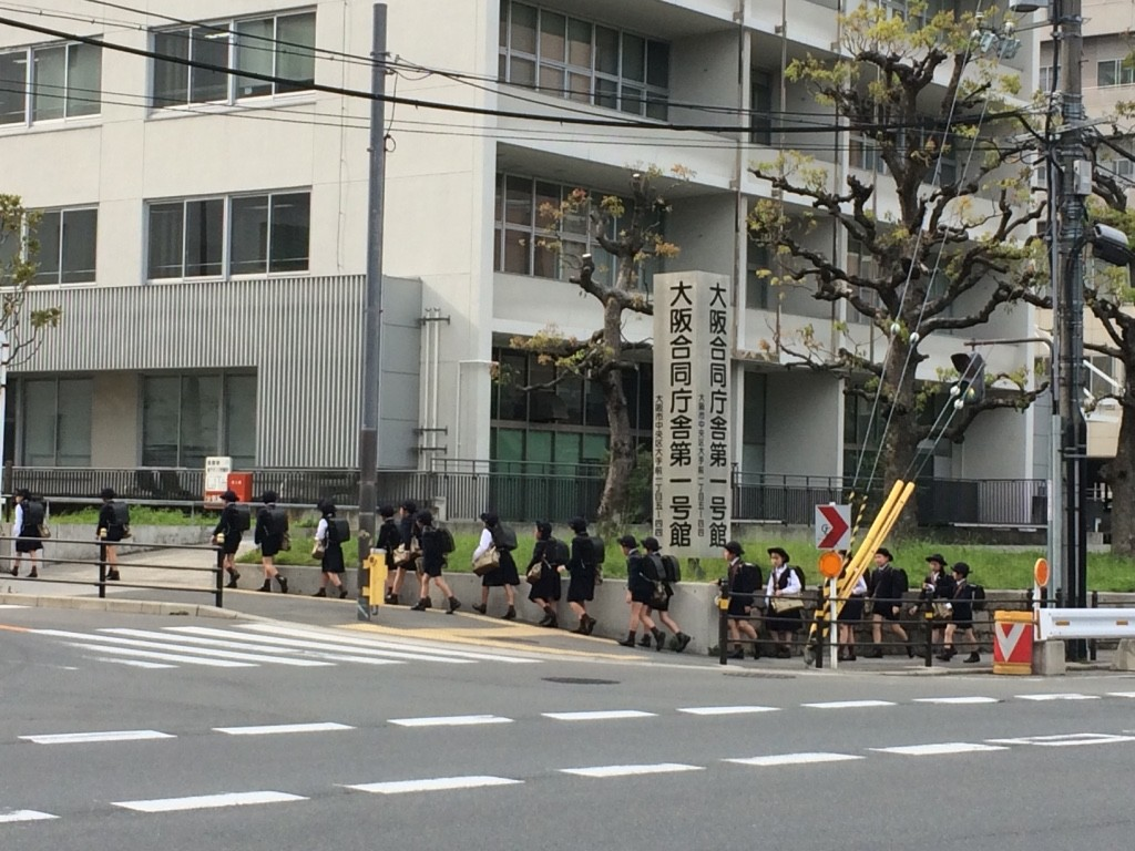 Across the street from the castle grounds, kids were getting out of school. They all walked down the block (there must have been over 100 of them). Their uniforms are so cute!