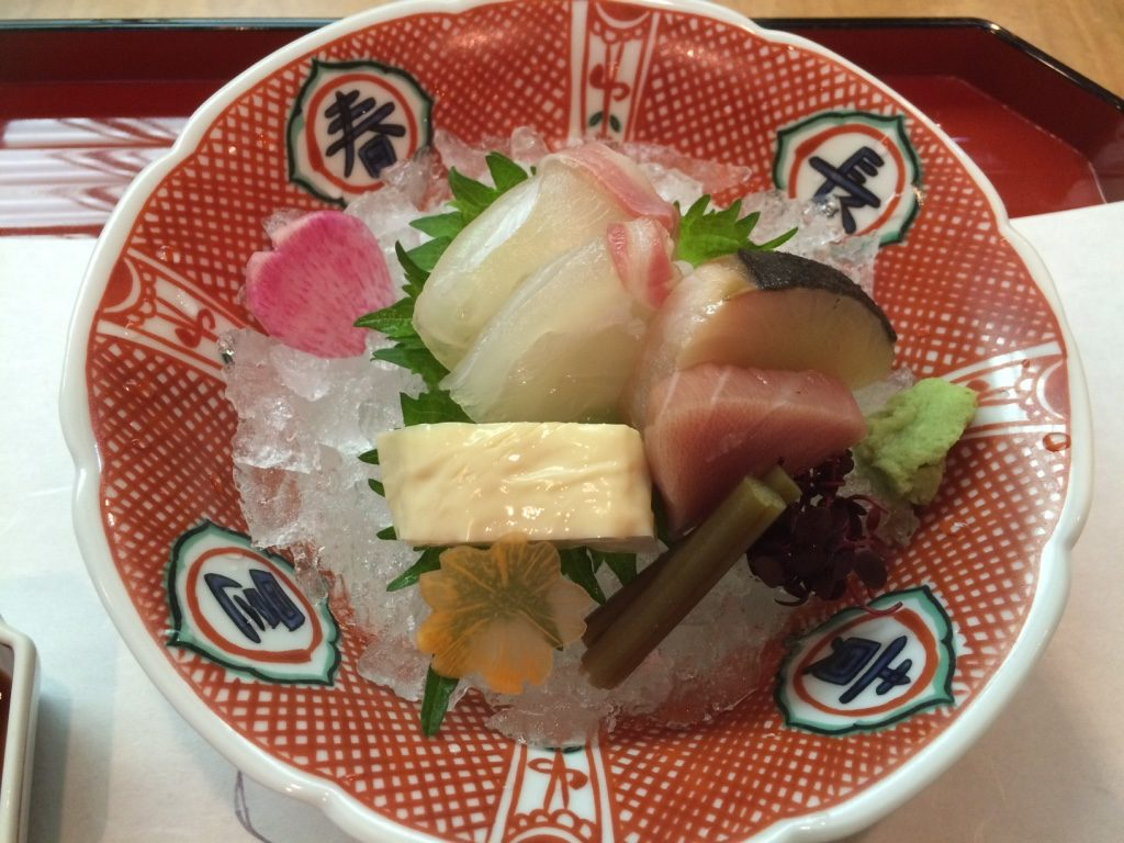 Second course is a sashimi plate