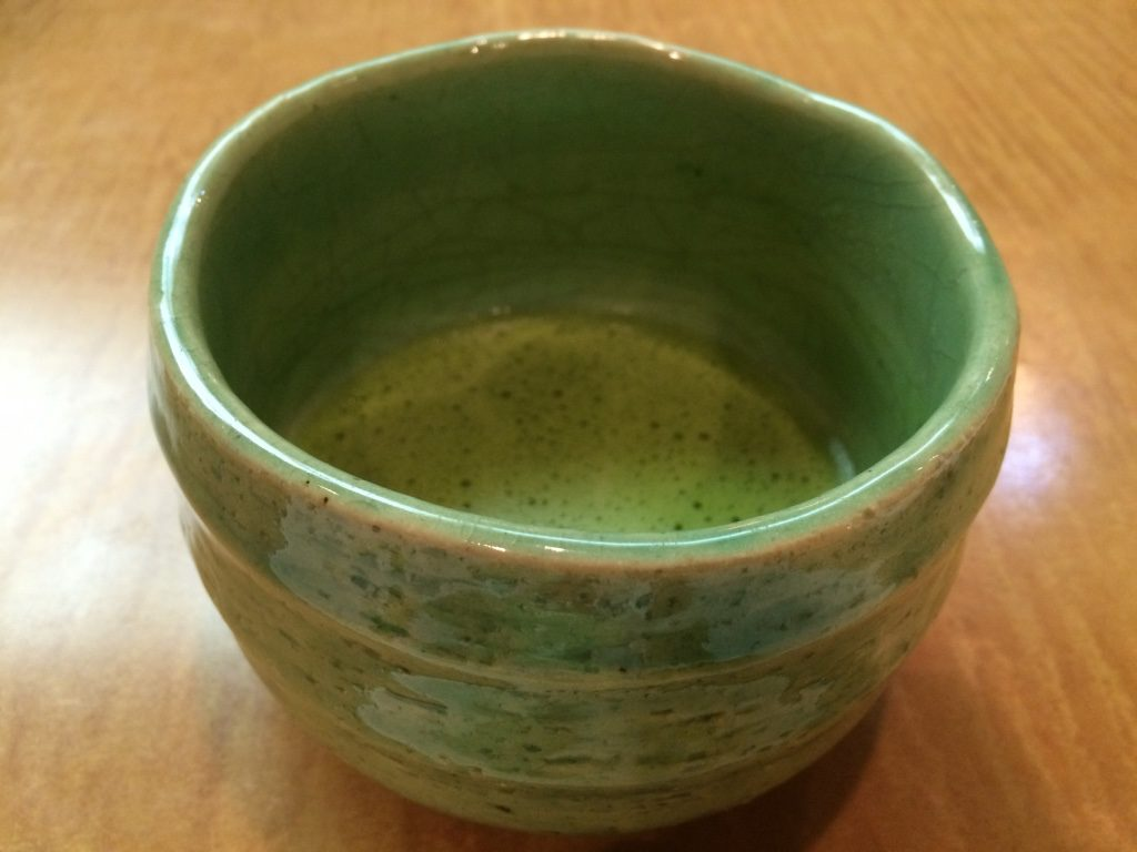 Hot matcha served with dessert. Very strong and not sweetened.