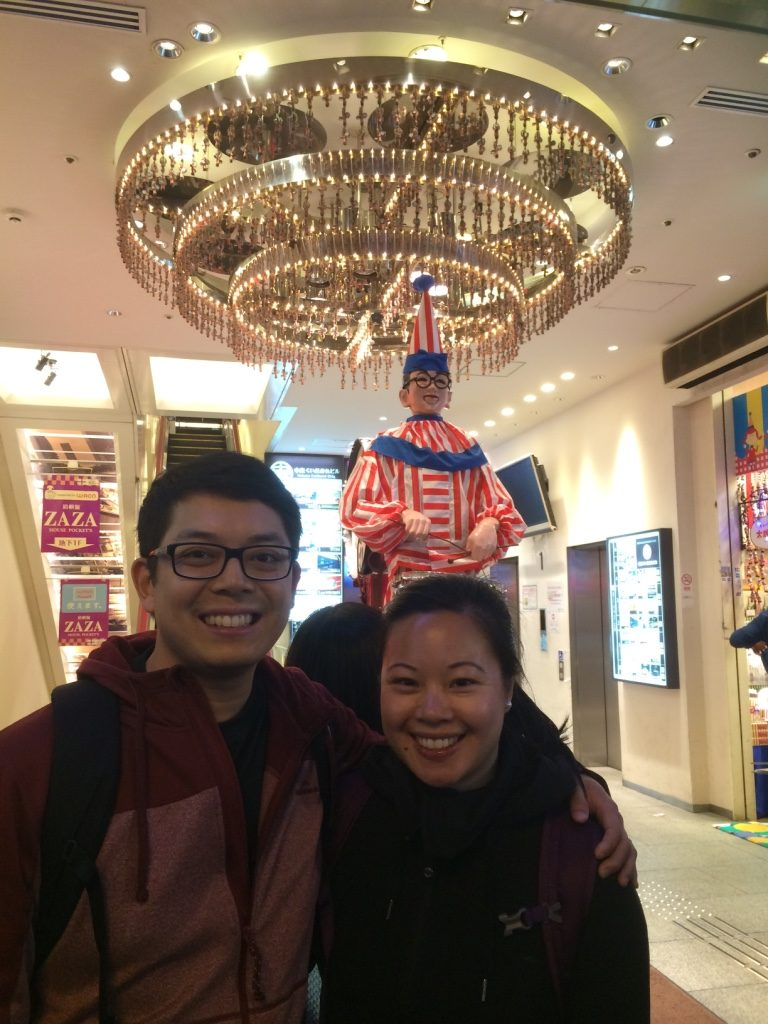The clown in the background is like a mascot for Osaka, so we took a picture.