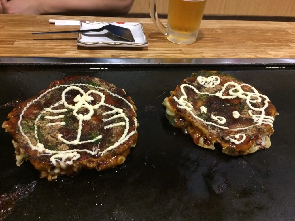 They draw cartoon characters on it with Japanese mayo! Doraemon for Tim and Hello Kitty for me.