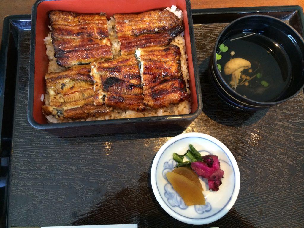 Unagi set: Box of unagi over rice, soup with unagi innards and pickles