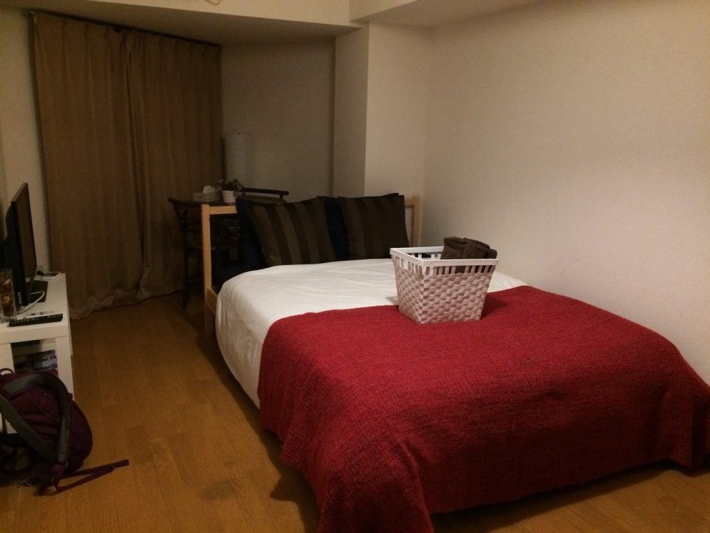 Double bed with a basket of towels. This is actually the same bed frame from Ikea that Tim has at home.