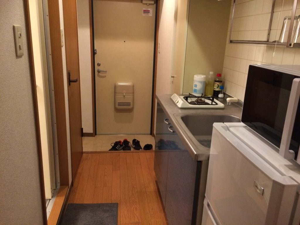 Kitchen to the right, washroom to the left. The washing machine is right by the front door.