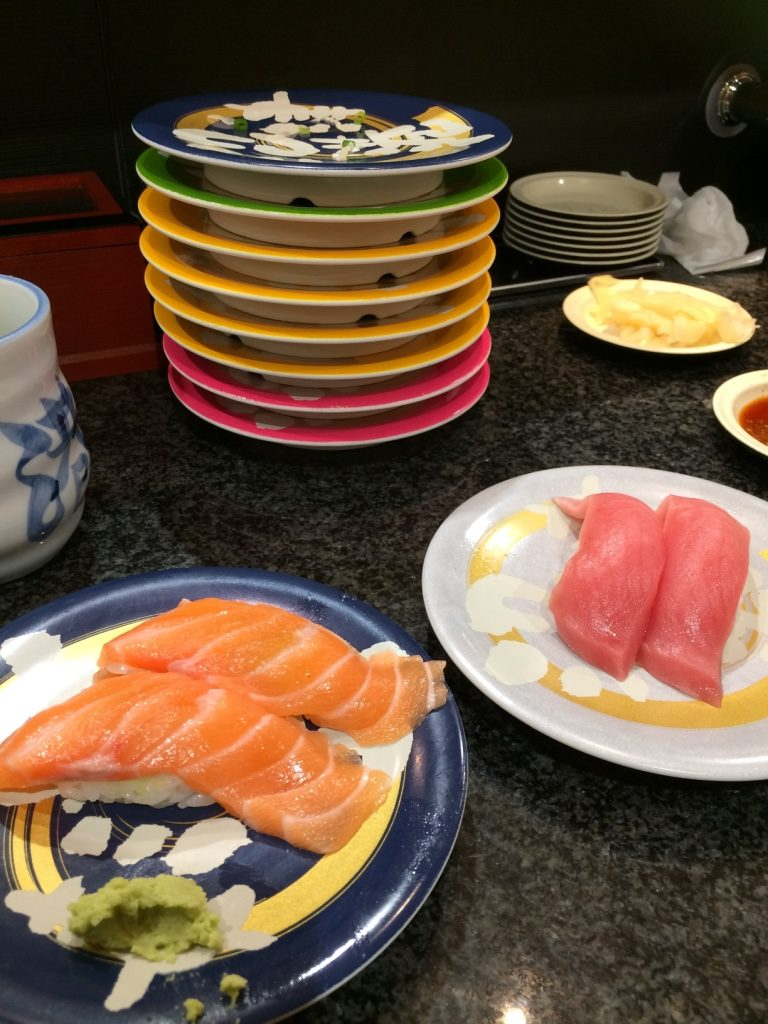 Fatty salmon and medium fatty tuna. Yum! Our pile of plates is getting higher.