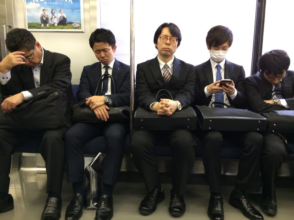 "On our way to Akihabara on the Chuo line, there were ""salarymen"" across from us (this was just after noon)"