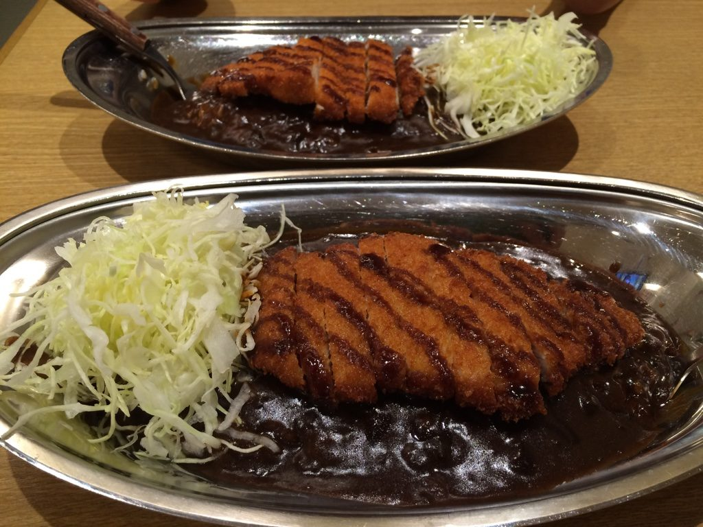 Chicken and Pork Cutlets. We both ordered the regular portion. The machine gives you a choice of 4 different sizes, but we realized after that the sizes are for the amount of rice. We probably could've gone with one size down.