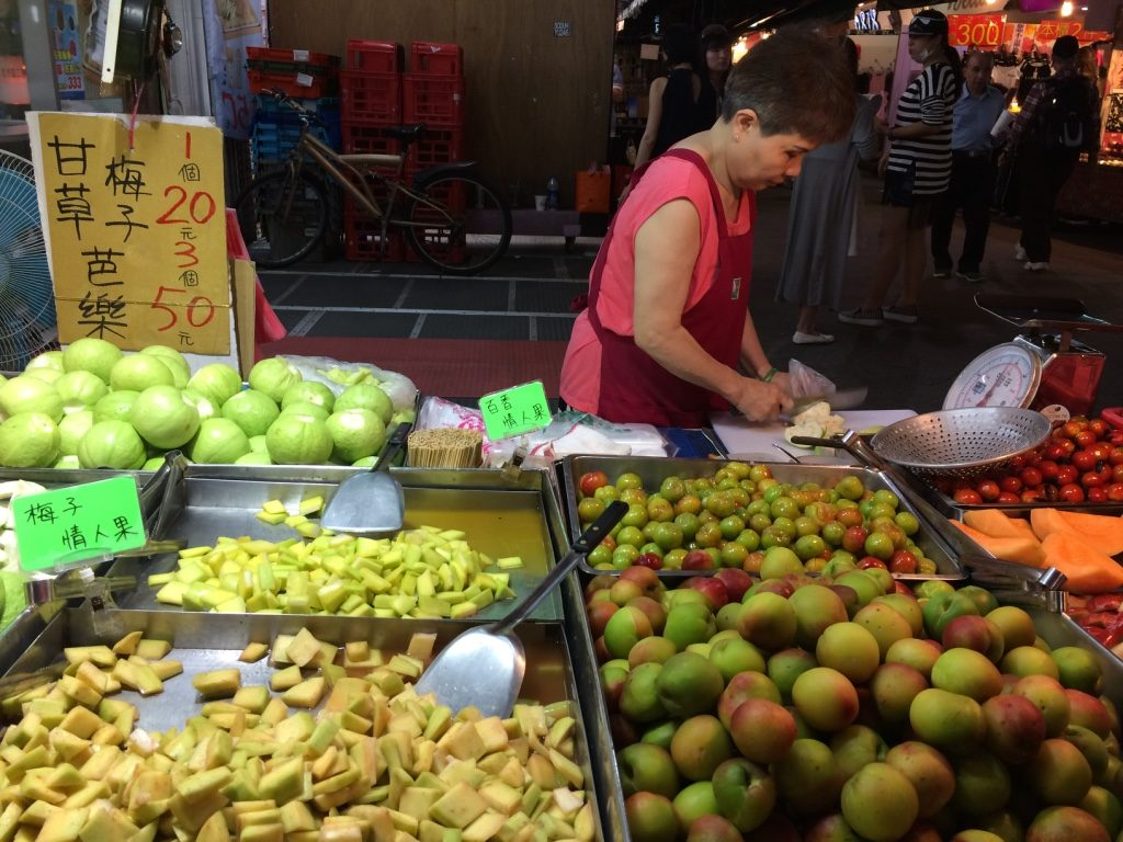 Our fruit lady at Linjiang Tonghua. Cut guava for 20 NT = $0.79 CAD