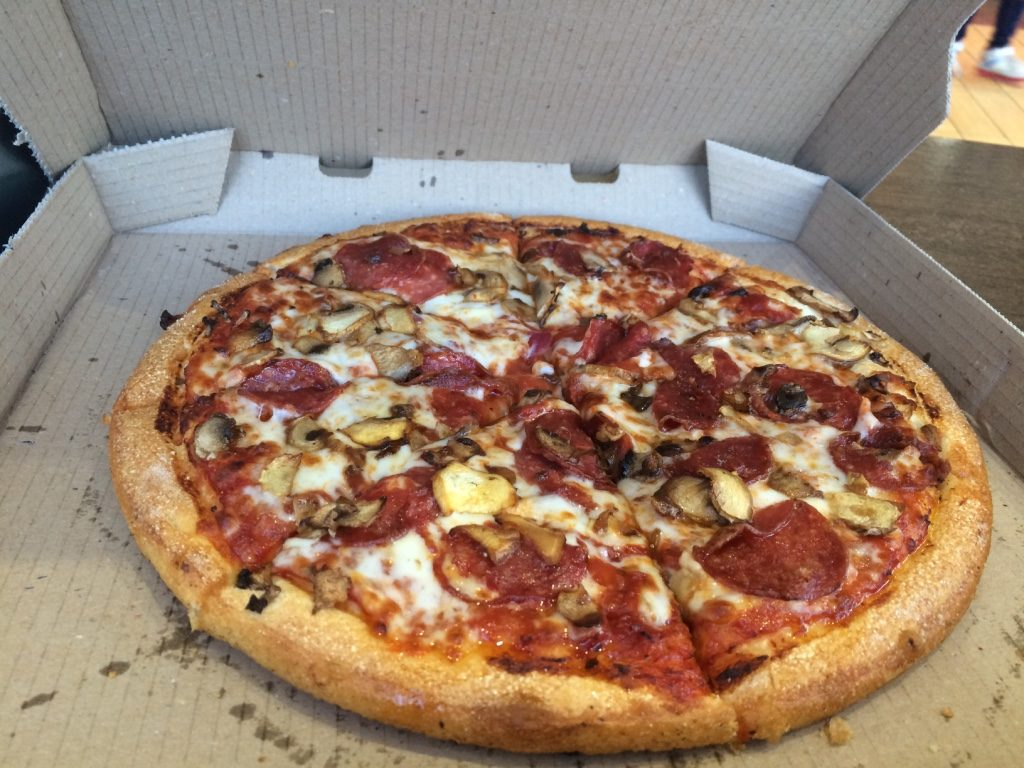 Pepperoni and mushroom pizza for $5 AUD = $4.70 CAD