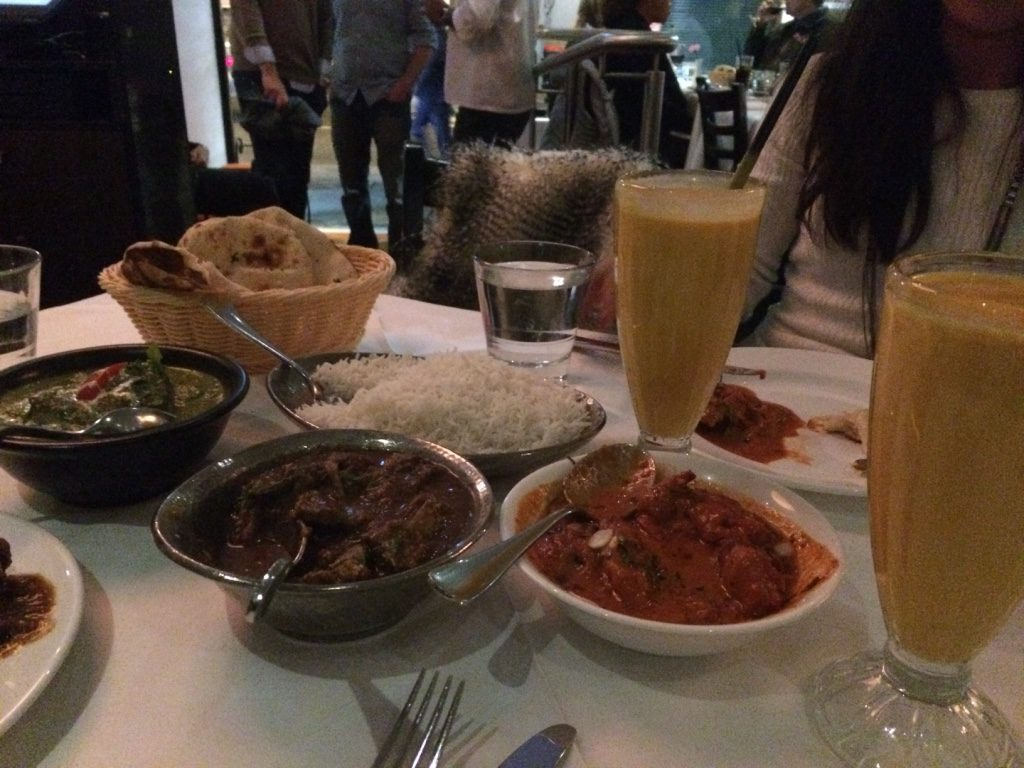 Palak paneer, goat curry, butter chicken, naan, rice and mango lassi ($88 AUD)