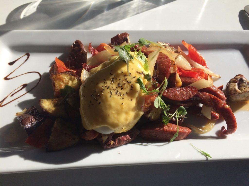Kumara Mumble Jumble: roasted kumara (Maori sweet potatoes), carmelized onions, chorizo, poached egg, roasted tomatoes ($17.50 NZD = $15.40 CAD)