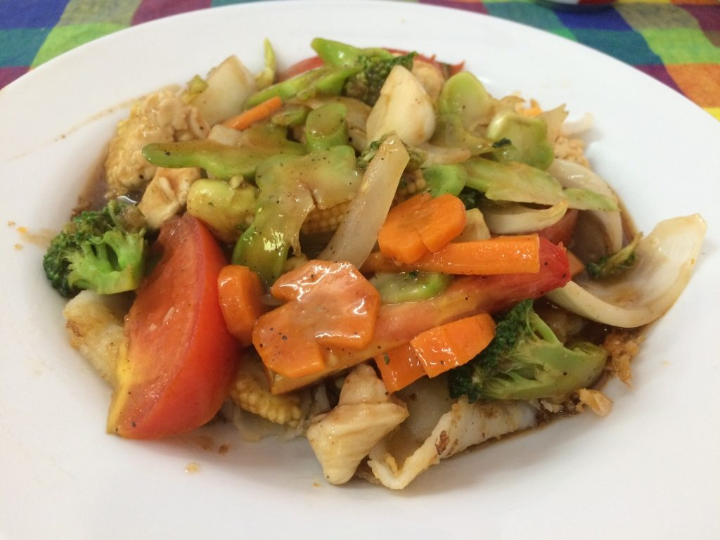 My noodles that are covered in chicken and lots of vegetables