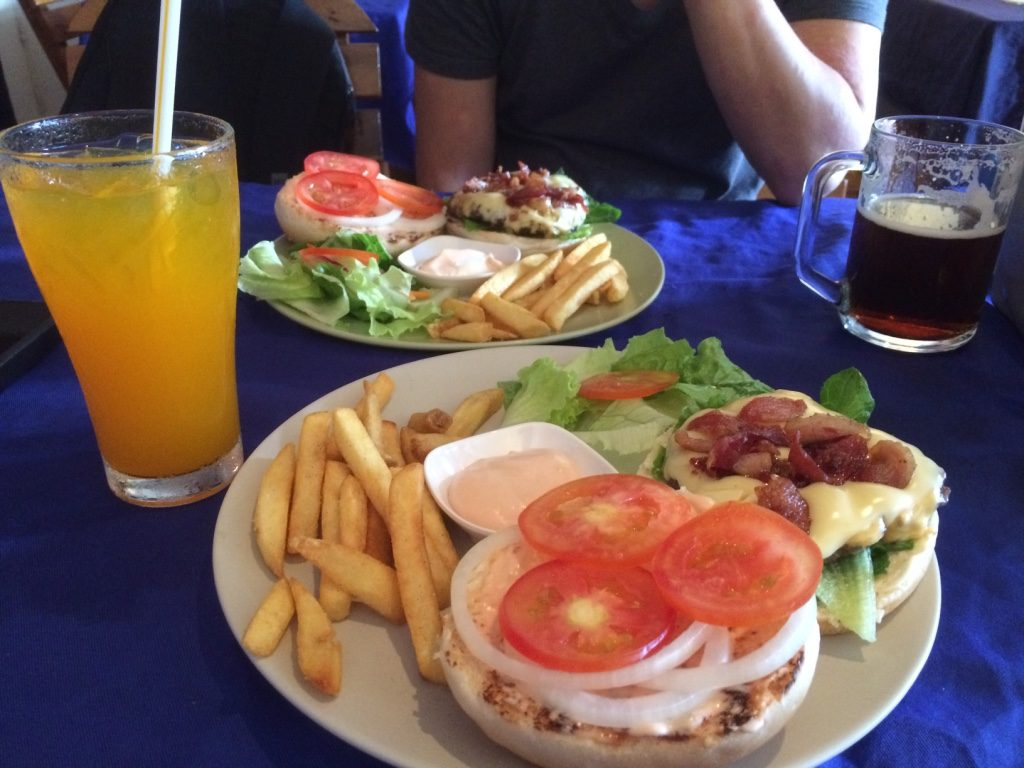 Our burgers and drinks - a pretty expensive meal here (112,000 LAK = $18 CAD)