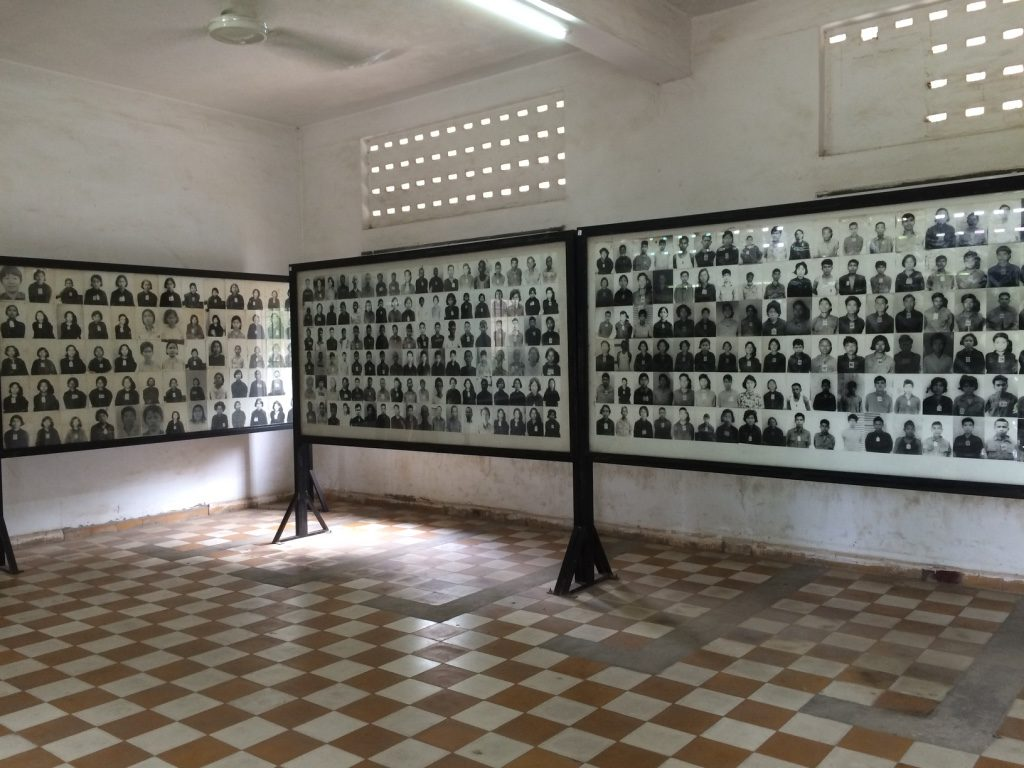 There were multiple rooms filled with photographs of all the people who came through S-21 and were executed.