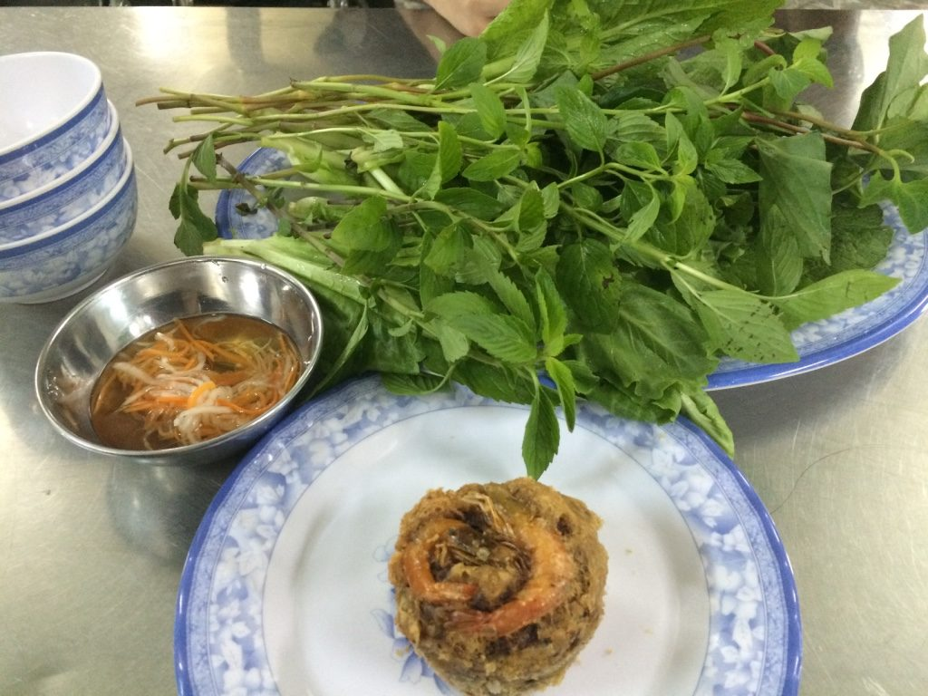 Bean muffin with mustard greens, lettuce and herbs. 8,000 VND = $0.45 CAD