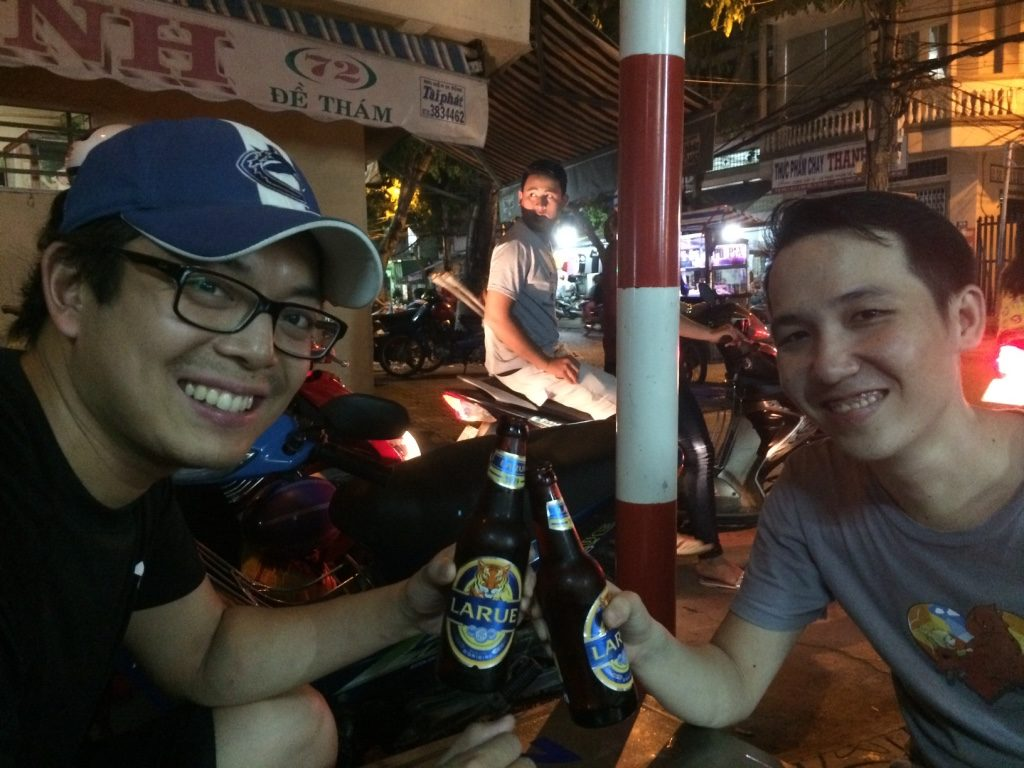Tim and Thoai cheerings their La Rue beer (10,000 VND = $0.56 CAD)