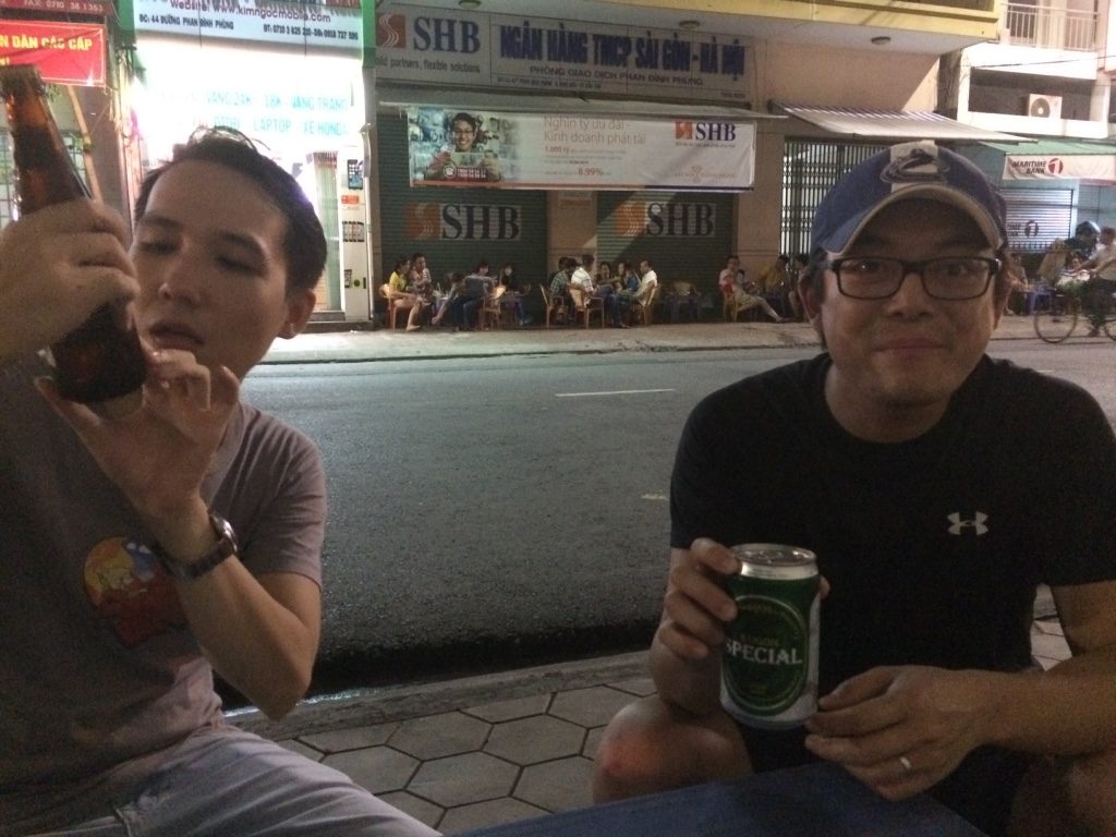 Thoai and Tim with their different Saigon beers