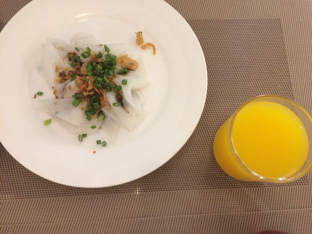 Our breakfast of choice at the hotel - rice noodles with green onions and fried scallions with fish sauce