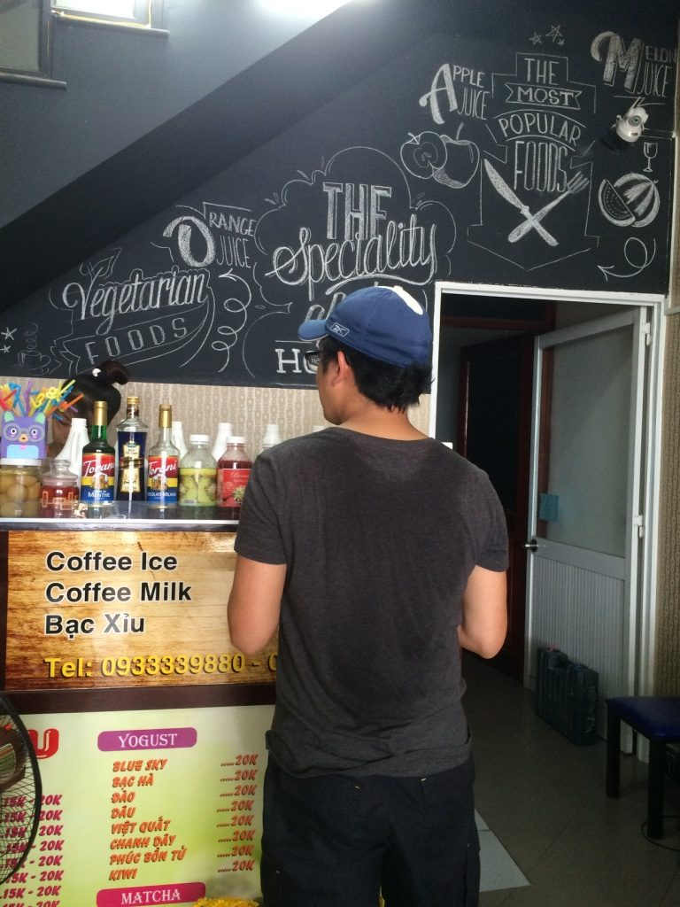 Tim ordering iced coffee. He was also carrying the backpack for a bit (if you couldn't already tell)