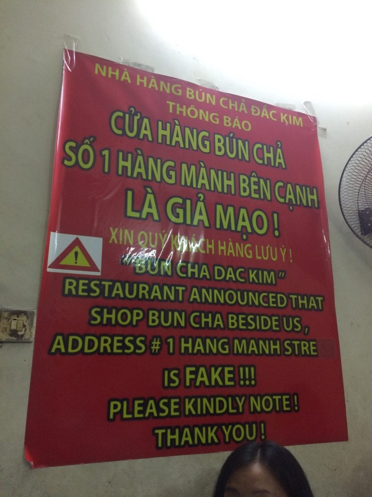 """The signage at the restaurant saying next door is """"fake"""". These signs were everywhere."""