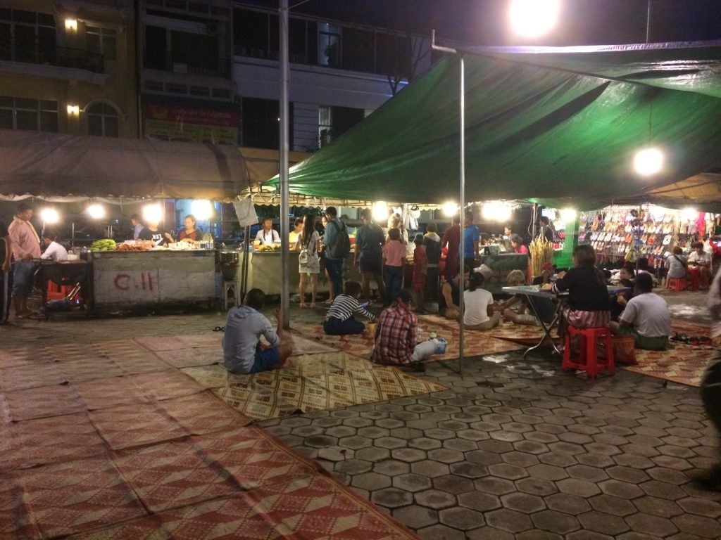Food stalls set blankets as as well as tables for customers