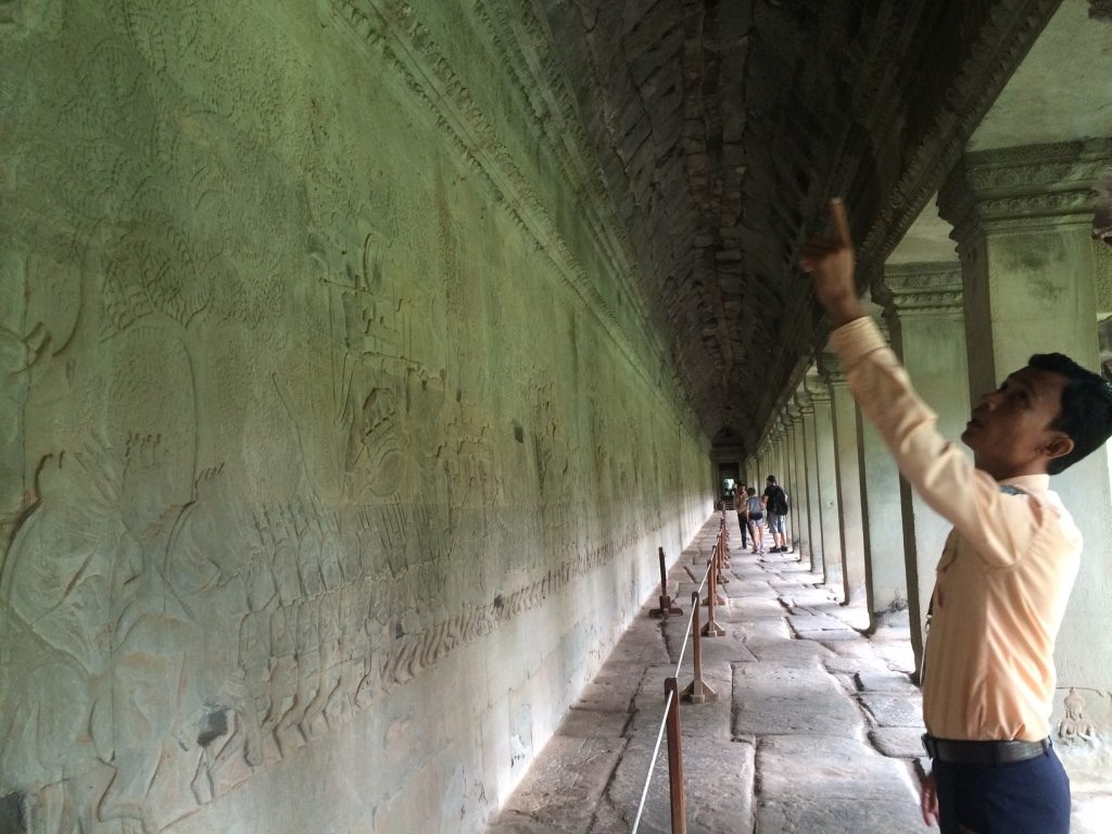Dara explaining the story of carvings at Angkor Wat