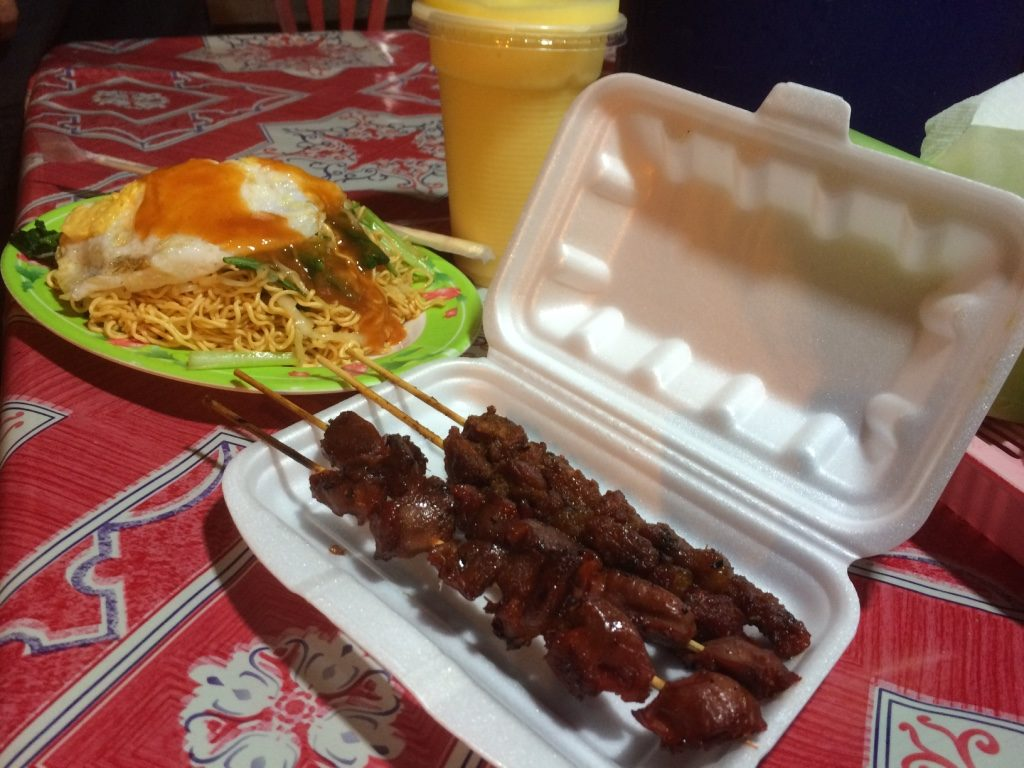 Our street dinner for $4 USD. Noodles and mango shake were $1 USD each and the skewers were $0.50 USD each