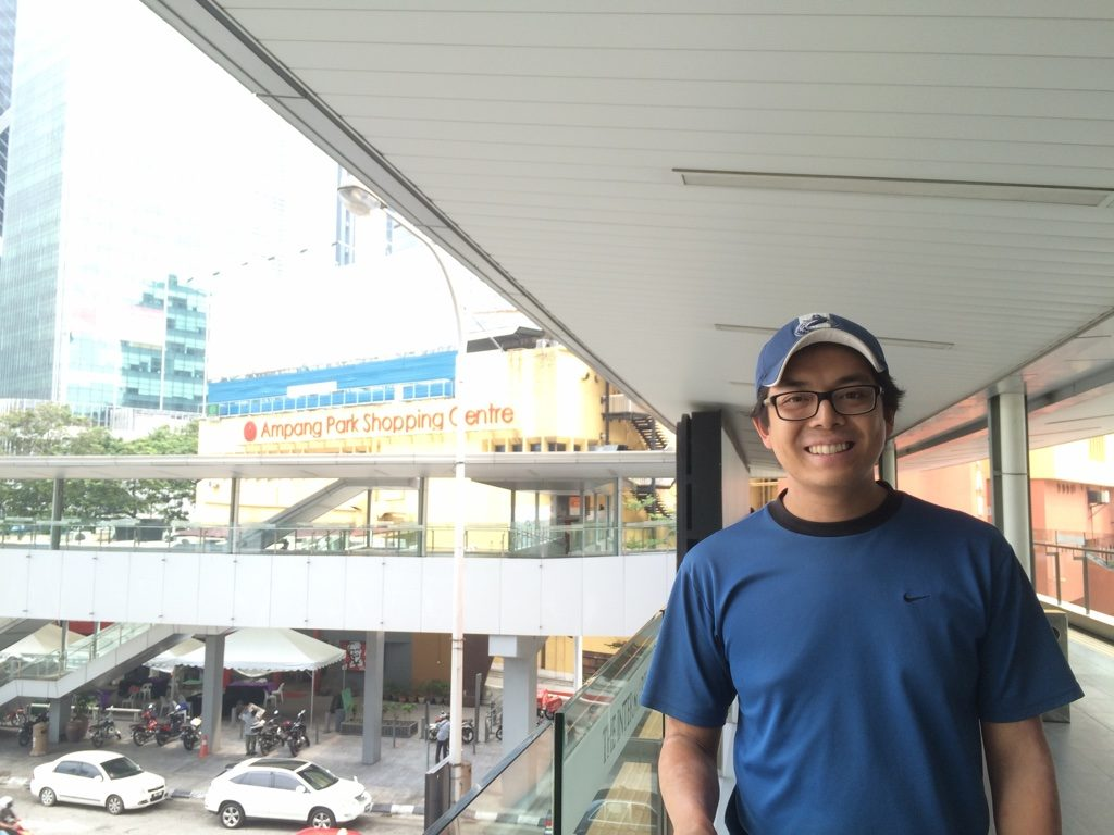 Walking across the overpass to Ampang Mall in the background
