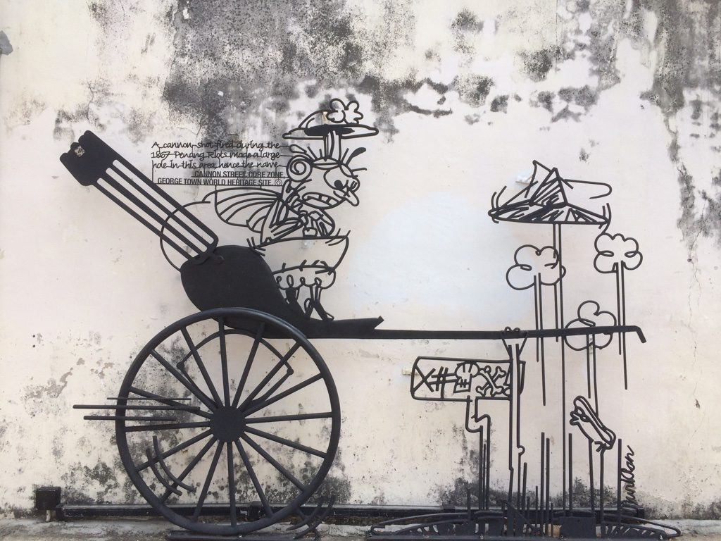 You can find these metal art cartoons all around George Town
